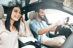 Man and a woman driving a car with fully comprehensive car insurance from Compare Insurance Ireland.