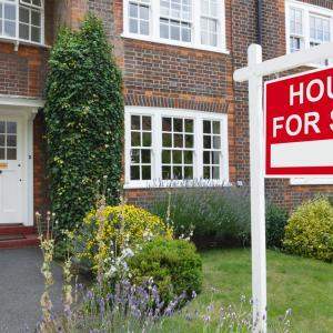 House with for sale sign, mortgage protection